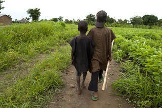 Children walk through a field | by World Bank Photo Collection