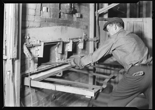 Man reaching into ovens, 1936 | by The U.S. National Archives