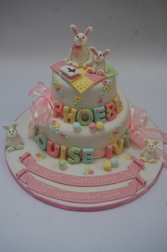 Wow! How pretty is this little girl's Christening Cake? Choose your favourite animal(s) as toppers! The Pastel Bunny Christening Cake - from £100.
