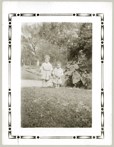 Two children in a garden