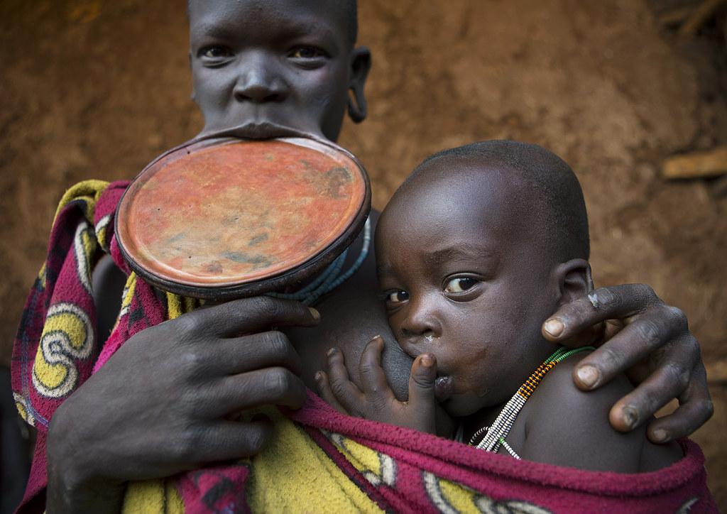 Suri Woman With Lip Plate Holding Her Baby Kibish Omo Va