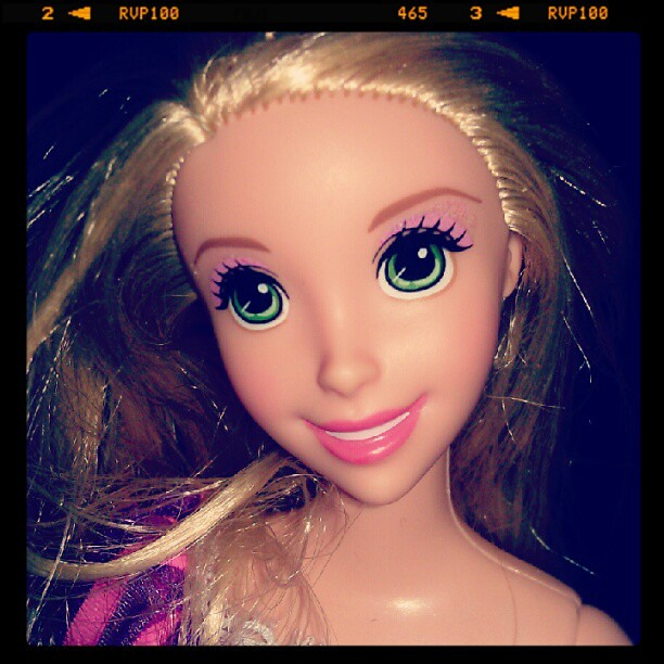 i can t get over how pretty the rapunzel barbies face is flickr