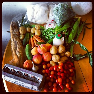 Lowell Farmers Market bounty: eggs, tomatoes, onions, garlic, peaches, cucumbers, bread, potatoes, MAPLE COTTON CANDY, cheese, basil, corn, Grade B syrup. I was basically hemorrhaging money dollahs while I was there! | by .mariannika.