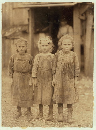 Josie, six year old, Bertha, six years old, Sophie, 10 years old, all shuck regularly. Maggioni Canning Co.  Location: Port Royal, South Carolina. (LOC) | by The Library of Congress