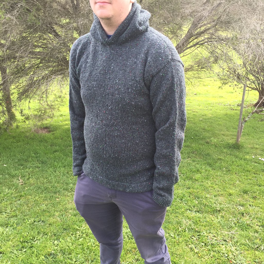 front view of matt's hoodie, knitted in jo sharp aran tweed aran in 'tartan' a dark green colour