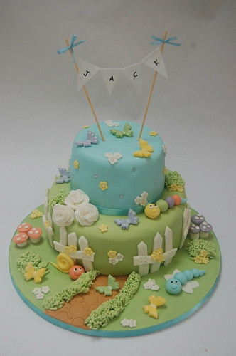 We've done a version of this for a little girl in the past, but adapted it this time for a baby boy with lovely pastel shades and cute garden animals. The Garden Christening Cake - from £90.