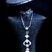 Diamond and pearl pendant on my Kosta Boda statuette