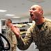 A Marine instructs a Midshipman.