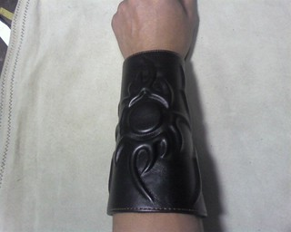 embossed leather bracer | by vinceisaac