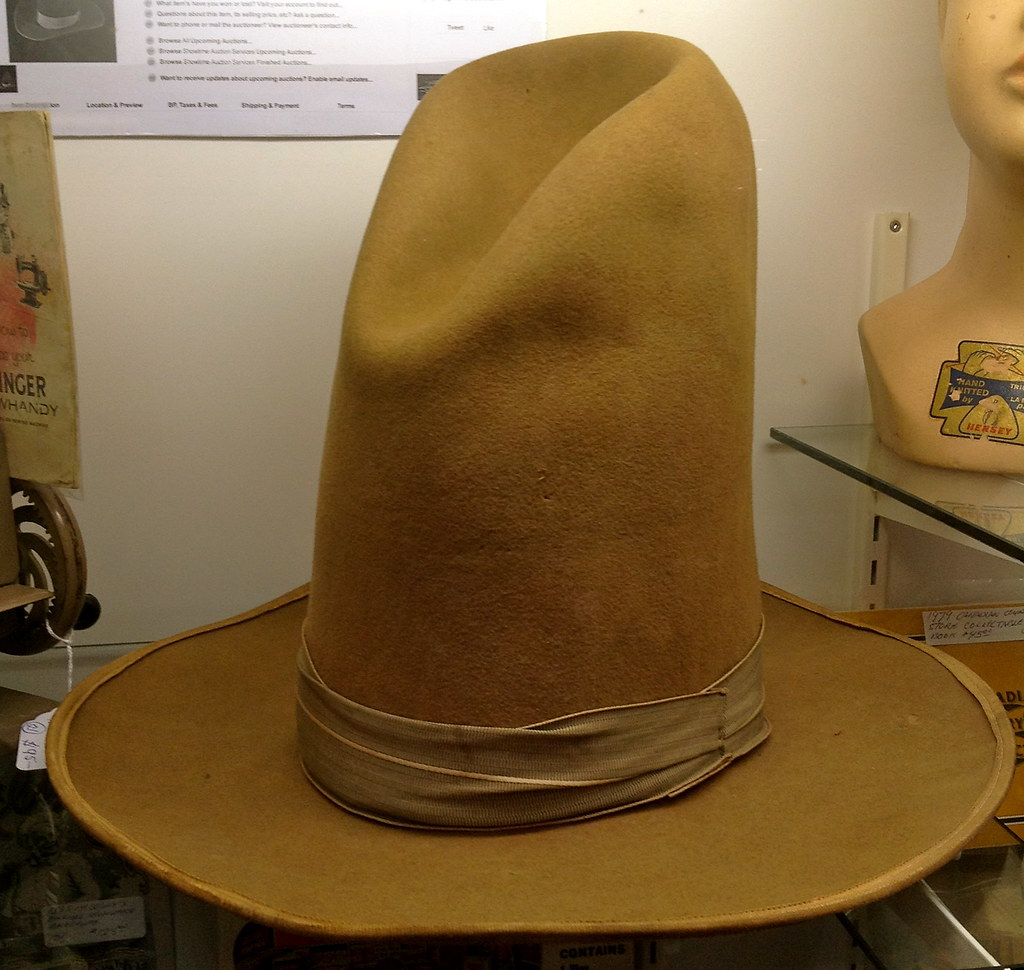 An Old Fashioned Very Tall Felt Cowboy Hat Was For Sale At