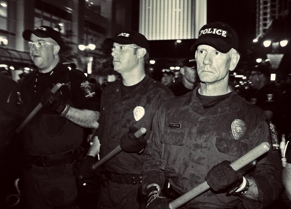 DNC Angry cops with batons by Jenna Pope