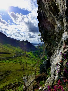 Cloudy, Rocky and Green Landscape | by Dafydd Em