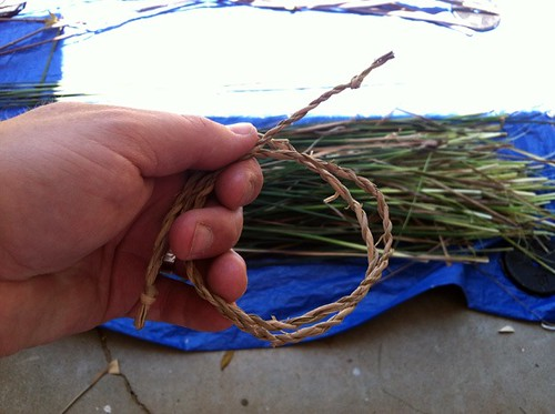 playing with cattail cordage.