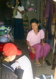A Burmese migrant answers a survey administered by an enumerator | by UN Migration Agency (IOM)
