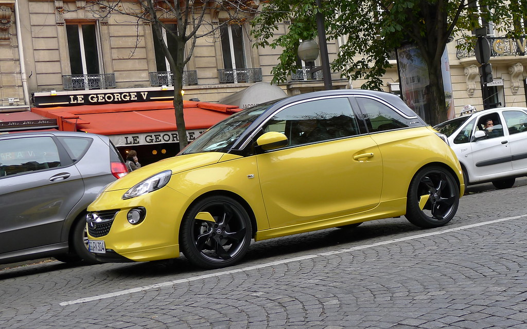 opel adam sunny yellow follow us on. Black Bedroom Furniture Sets. Home Design Ideas