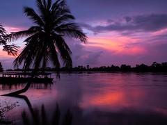 Sunset over Mekong by Kuba Abramowicz