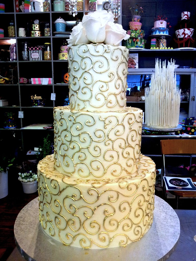 3 Tier Wicked Chocolate Wedding Cake Iced In White Ganache Decorated With Piped Gold