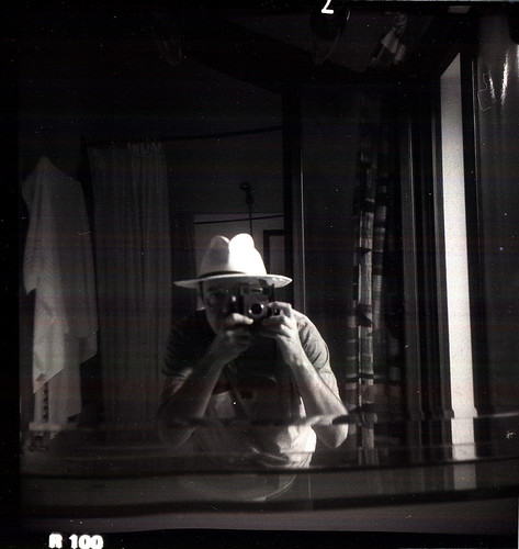 reflected self-portrait with Brownie Starmatic camera and borrowed hat | by pho-Tony