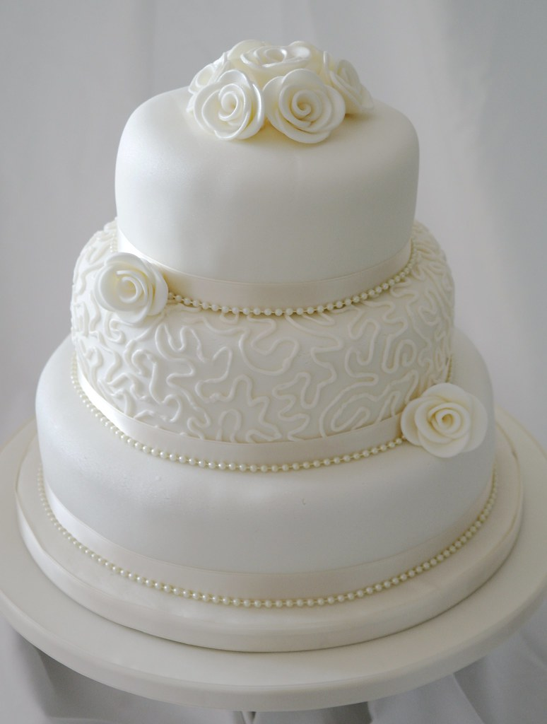 how much for a 3 tier wedding cake uk filigree roses wedding cake three tier ivory cake with 15473