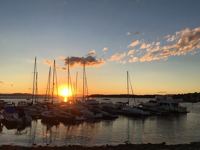 Sunset Behind The Sailboats