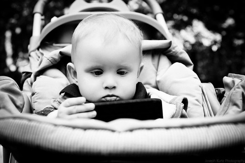Baby on a cell phone. | by Joseph Kurtz Photography
