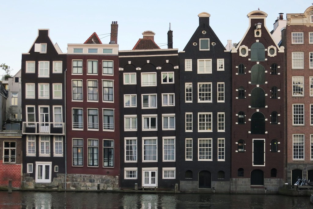 Houses along the Damrak canal in Amsterdam