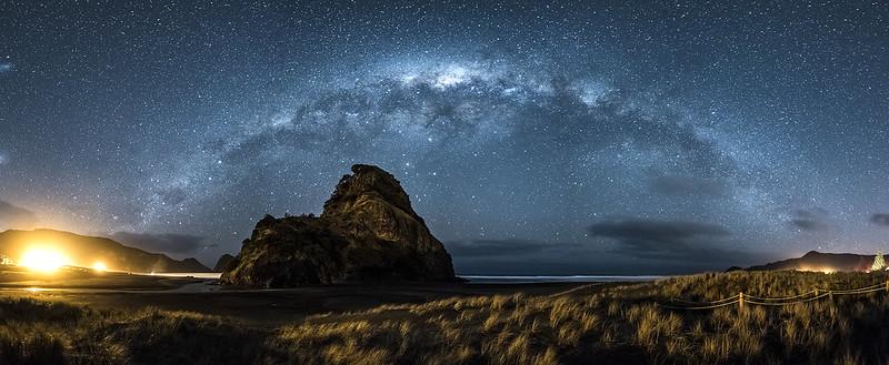 Panorama Milky way over Lion rock at Piha