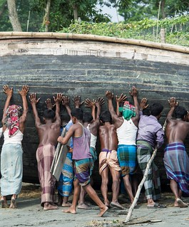 Fisher men lifting a boat in Bangladesh. Photo by Finn Thilsted | by WorldFish