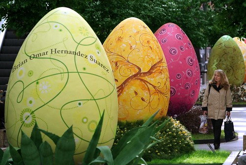 A woman walks among giant Easter eggs -despues | by Brian_Hdz
