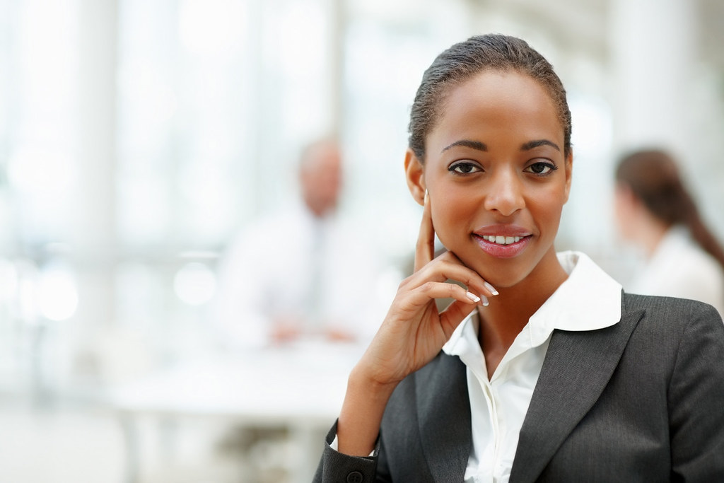 a smiling young african american business woman