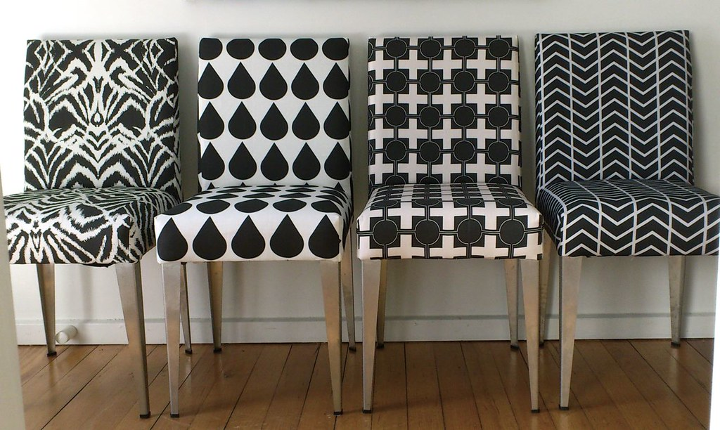 Dining chairs in black and white salvaged chairs from for Black and white fabric dining chairs
