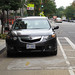 Acura with DC Tags DP 8491 Parked in Cycletrack