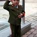 Cute North Korean kid salutes...