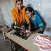 006 A woman receives a new sewing machine and vocational training through UNDP-Pakistan's Early Recovery Programme.