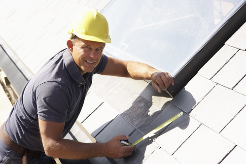 Roofer Working On Exterior Of New Home | by homesensible