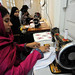 Students learn to operate the sewing machines