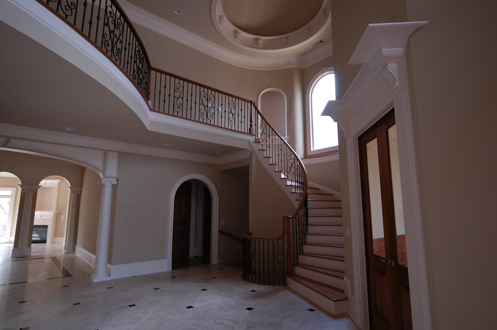 Foyer Ceiling Jobs : Grand foyer with curved stairway and dome trey ceiling