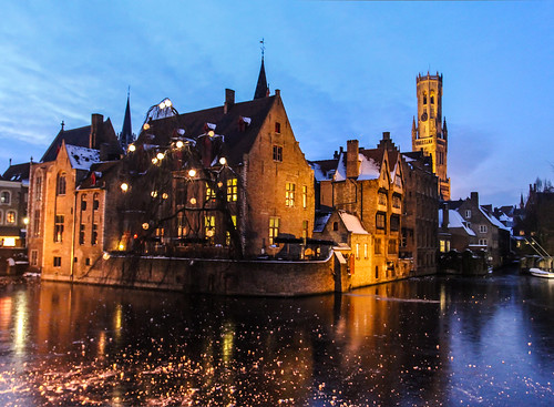 bruges at nightfall with the famous belfry in the backgrou