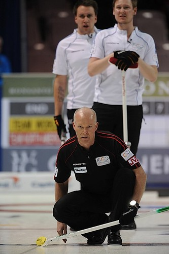 Penticton B.C.Jan12_2013.World Financial Group Continental Cup.Team North America skip Glenn Howard,Team World lead Victor Kjall,second Frederick Lindberg.CCA/michael burns photo | by seasonofchampions