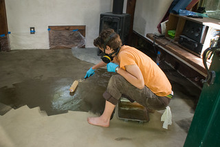 Camille Applying Oil Mixture on Earthen Floor | by goingslowly