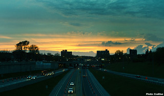 sunset over the decarie | by Eva Blue