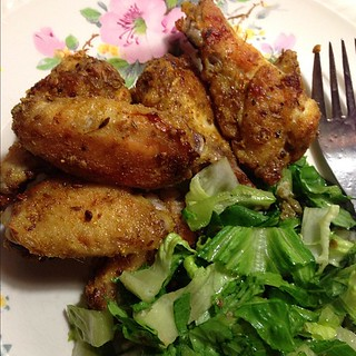 For dinner I dusted chicken wings with cumin seed, coriander seed, & salt ground in mortar/pestle + curry powder, orange zest & spelt flour.Then baked in oven.  + salad | by yougrowgirl