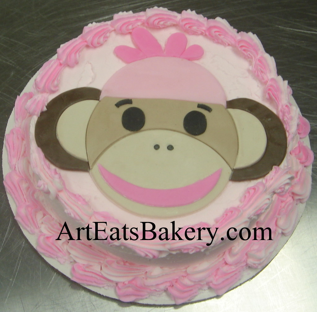 Cake Designs Jackie Brown Croydon : Girl s creative pink butter cream and brown fondant sock m ...