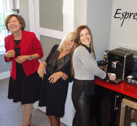 Three women enjoying the shop's espresso bar