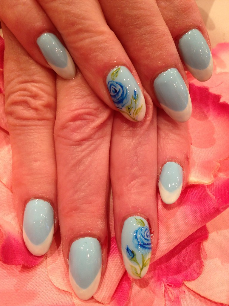 Blue polish with white French tips on almond shape nails w… | Flickr