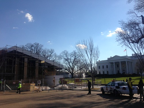 The smell of sawdust is in the air outside the White House. The US flag flies at half mast above it. | by Divergence
