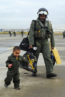 An aviator walks with his son after returning home. | by Official U.S. Navy Imagery