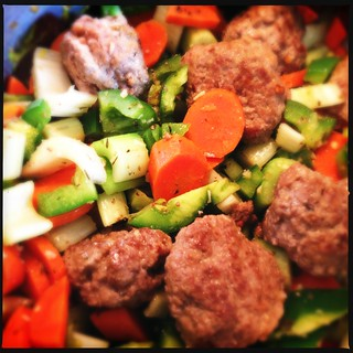 Meatballs added to vegetable mix | by swanksalot