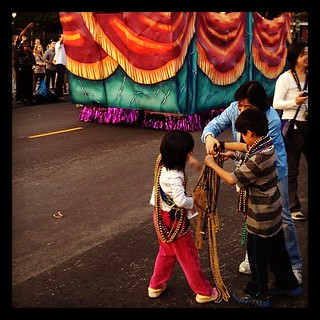 Kids in a bead frenzy at the New Orleans Thanksgiving parade | by Downtown Traveler