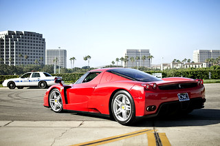 Red Enzo leaving Cars and Coffee | by Axion23